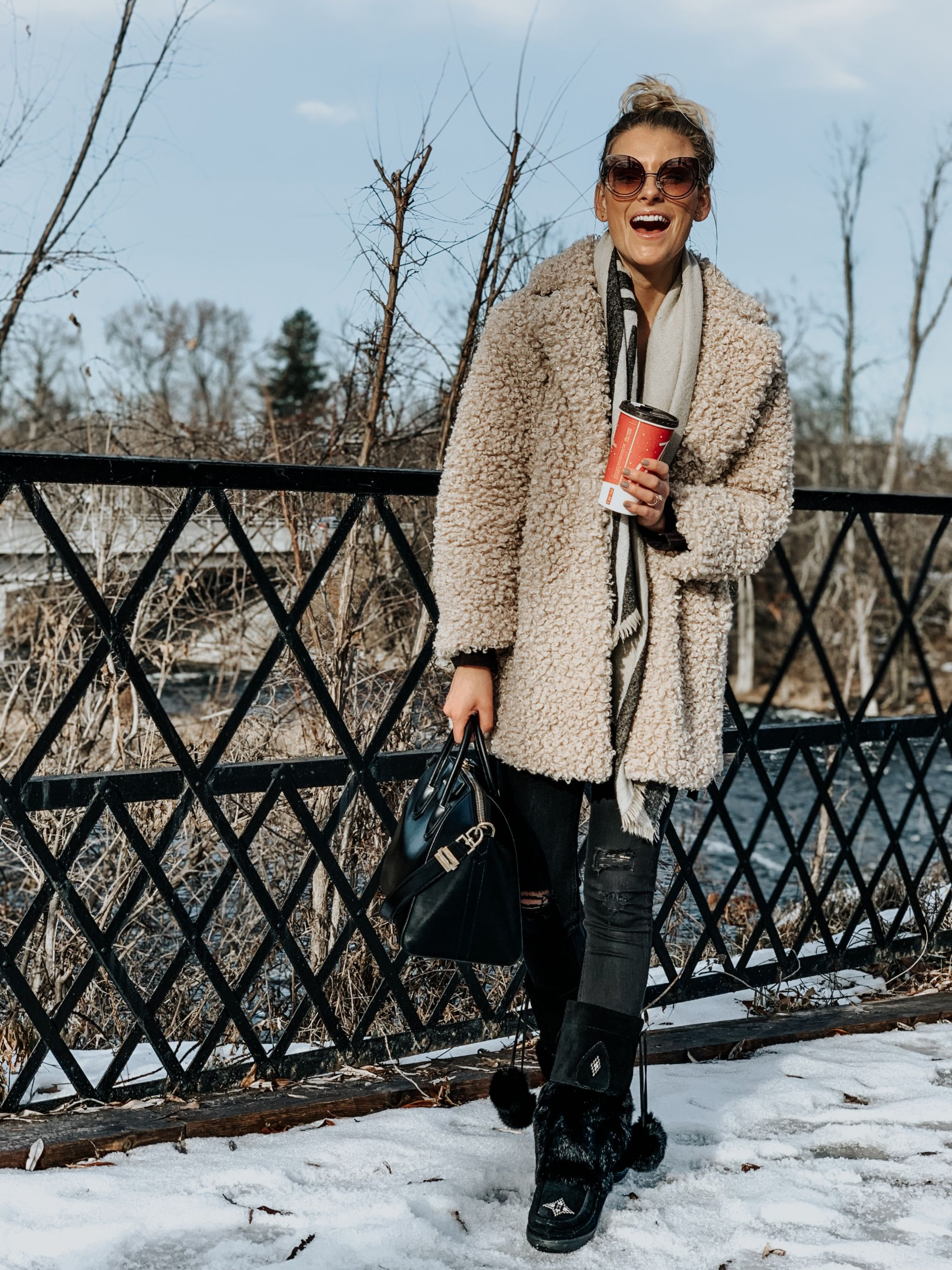 blogger wearing mukluks and teddy coat