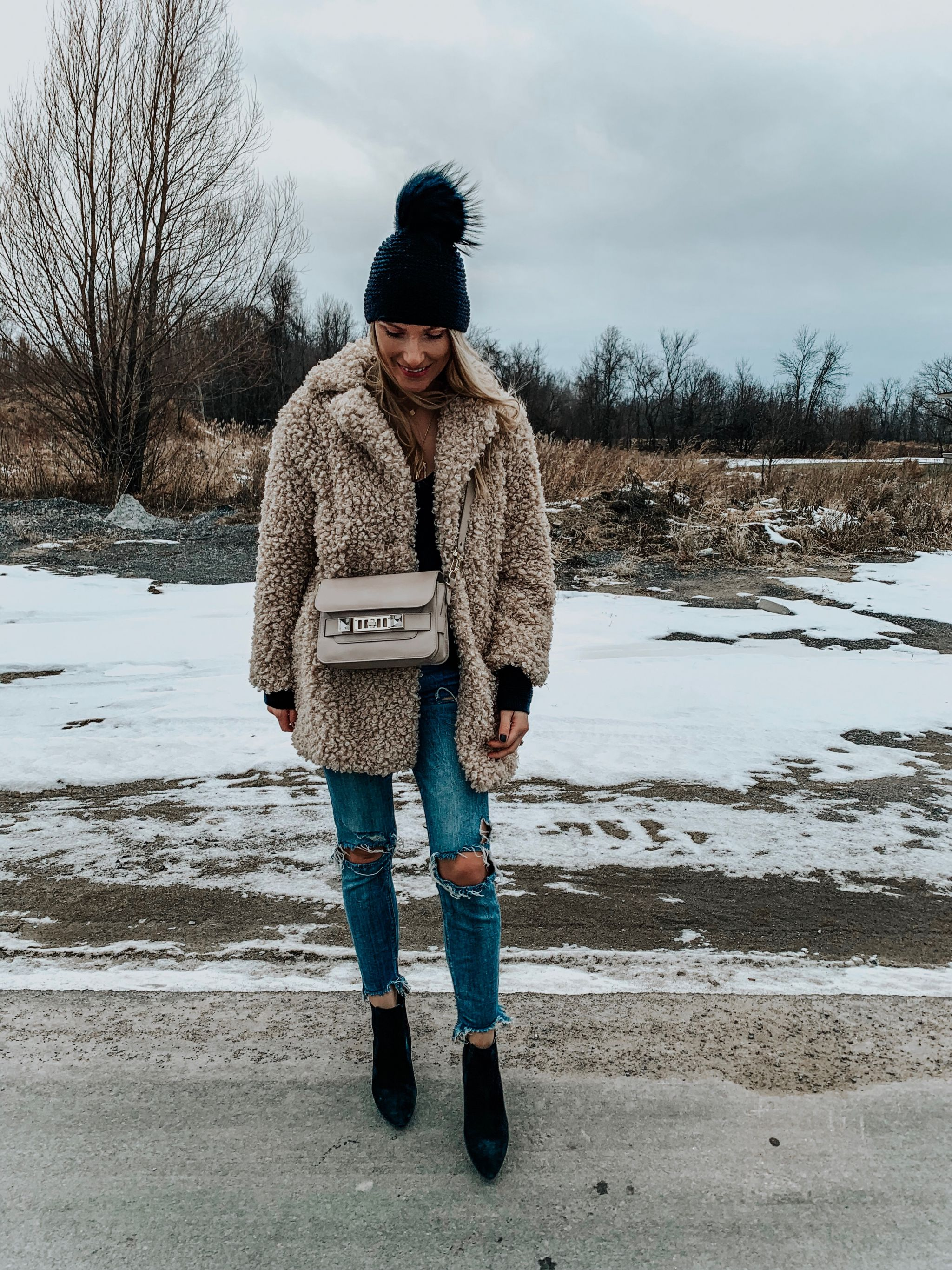 1 girl wearing winter hat and coat in the snow, stylish winter outfit