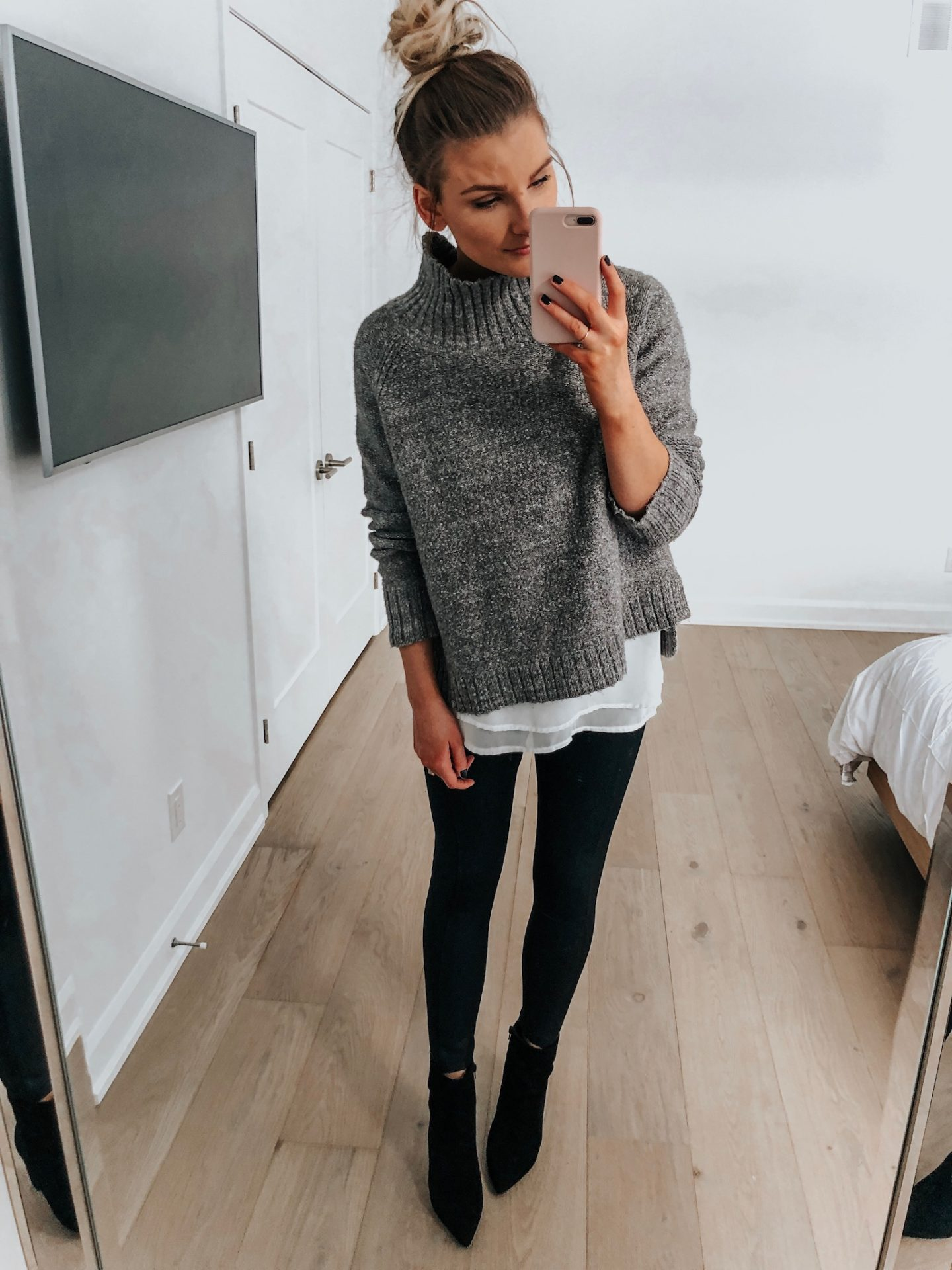 girl wearing grey oversized mock neck sweater and black lysse leggings with booties