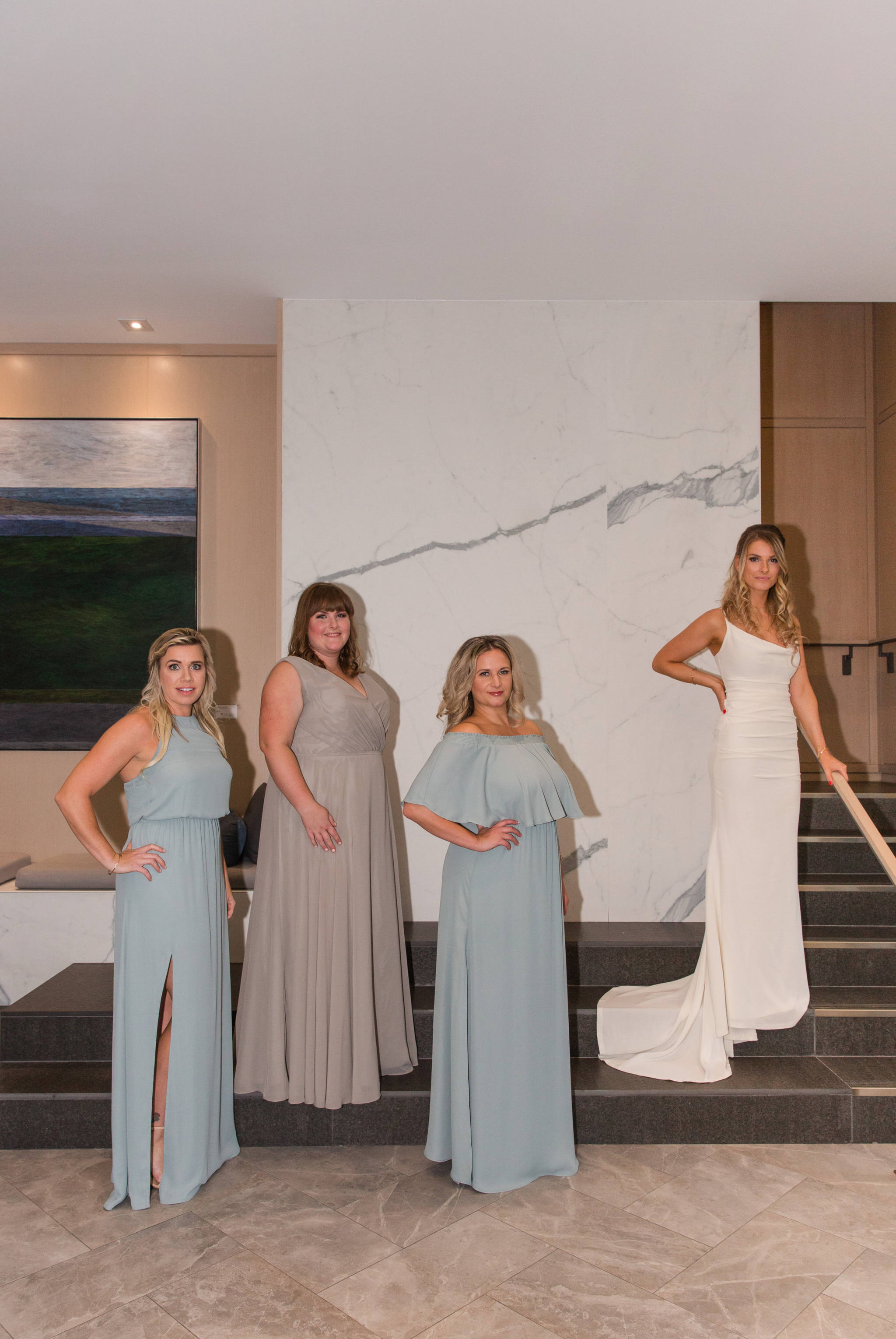 life with aco wedding, three bridesmaids in sage green dresses standing with bride at andaz hotel lobby