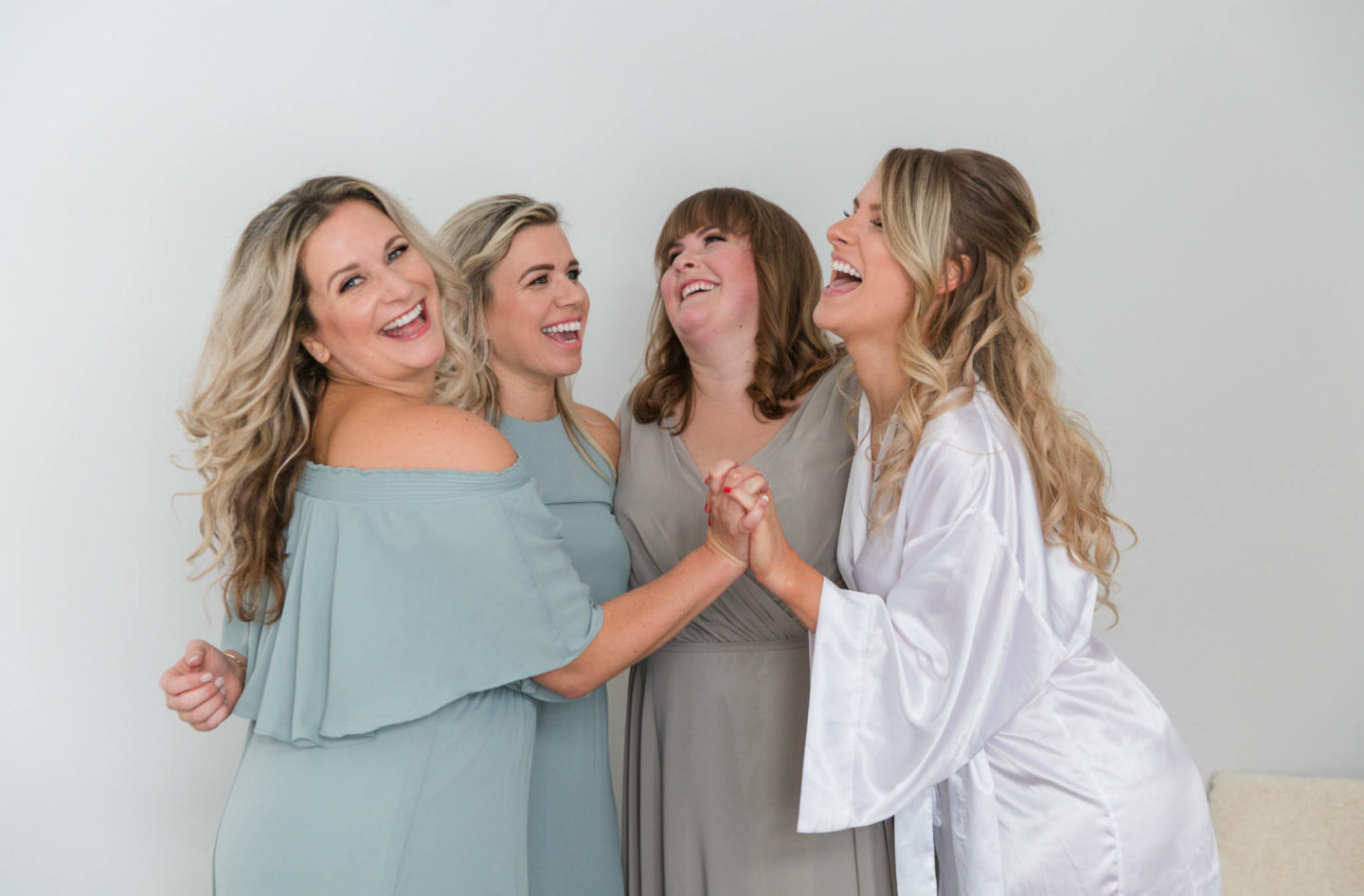 show me your mumu bridesmaids laughing with bride