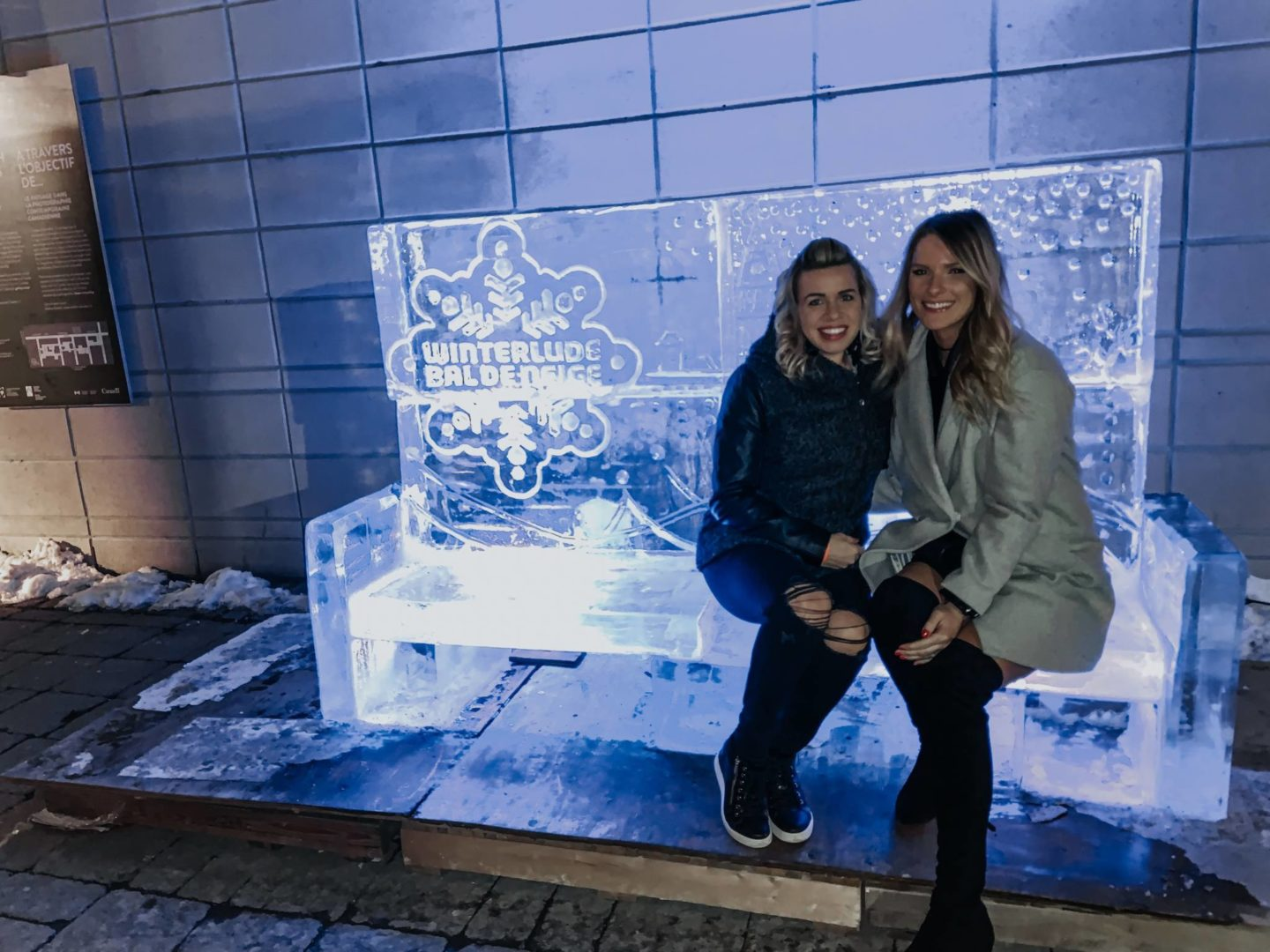 winterlude ice bench with two girls sitting on it