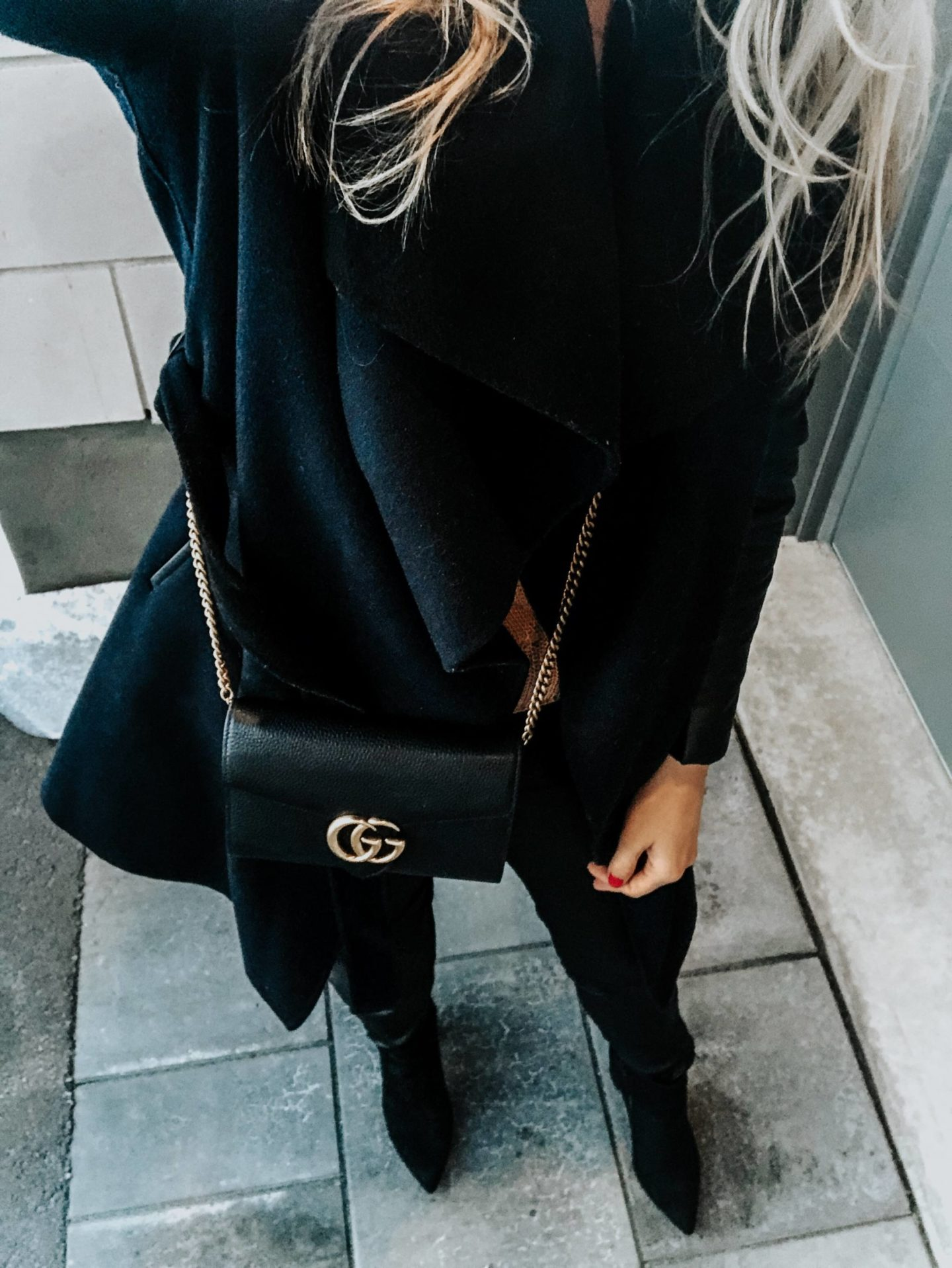 from where i stand photo of girl wearing all black and gucci bag