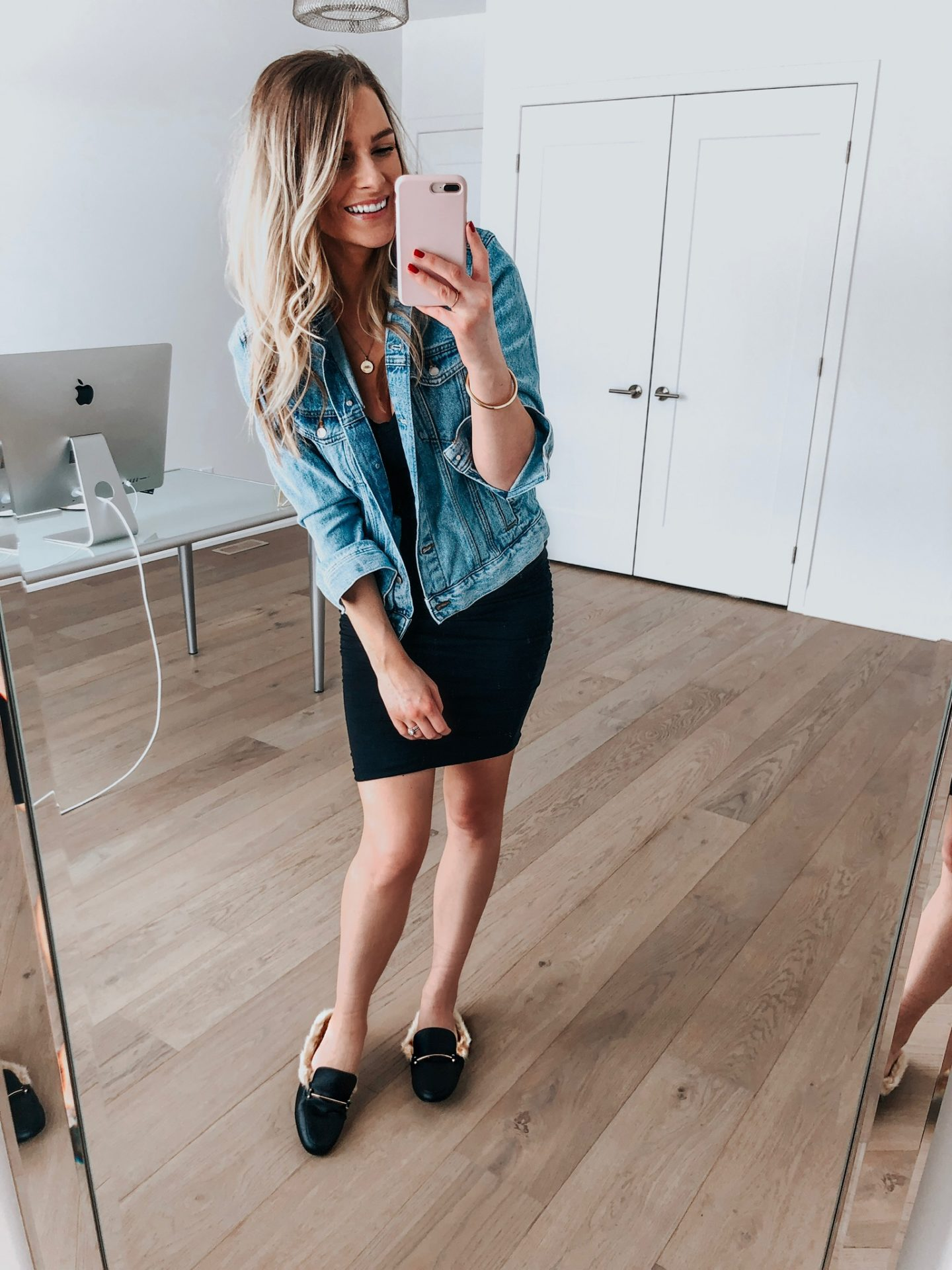 blonde blogger wearing fur slides mules with black dress and denim jacket