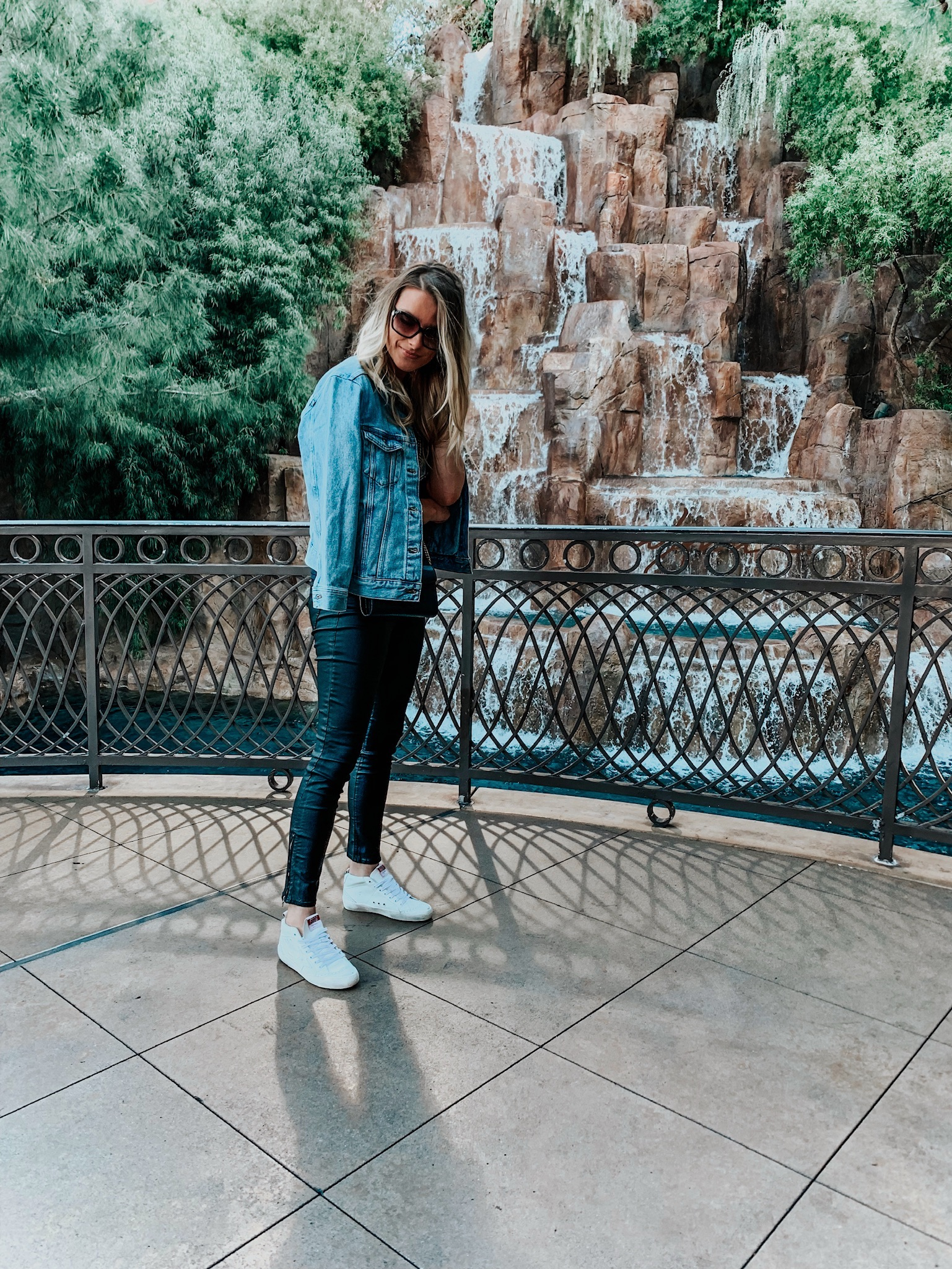 girl wearing casual outfit with white golden goose sneakers