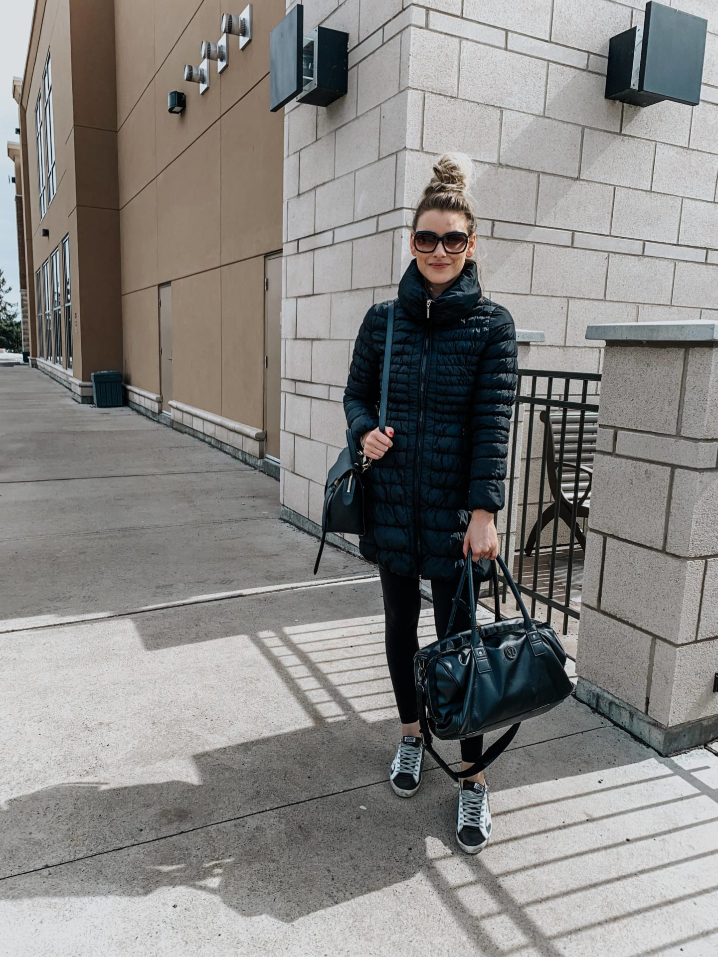 blonde wearing athleisure outfit with golden goose sneakers