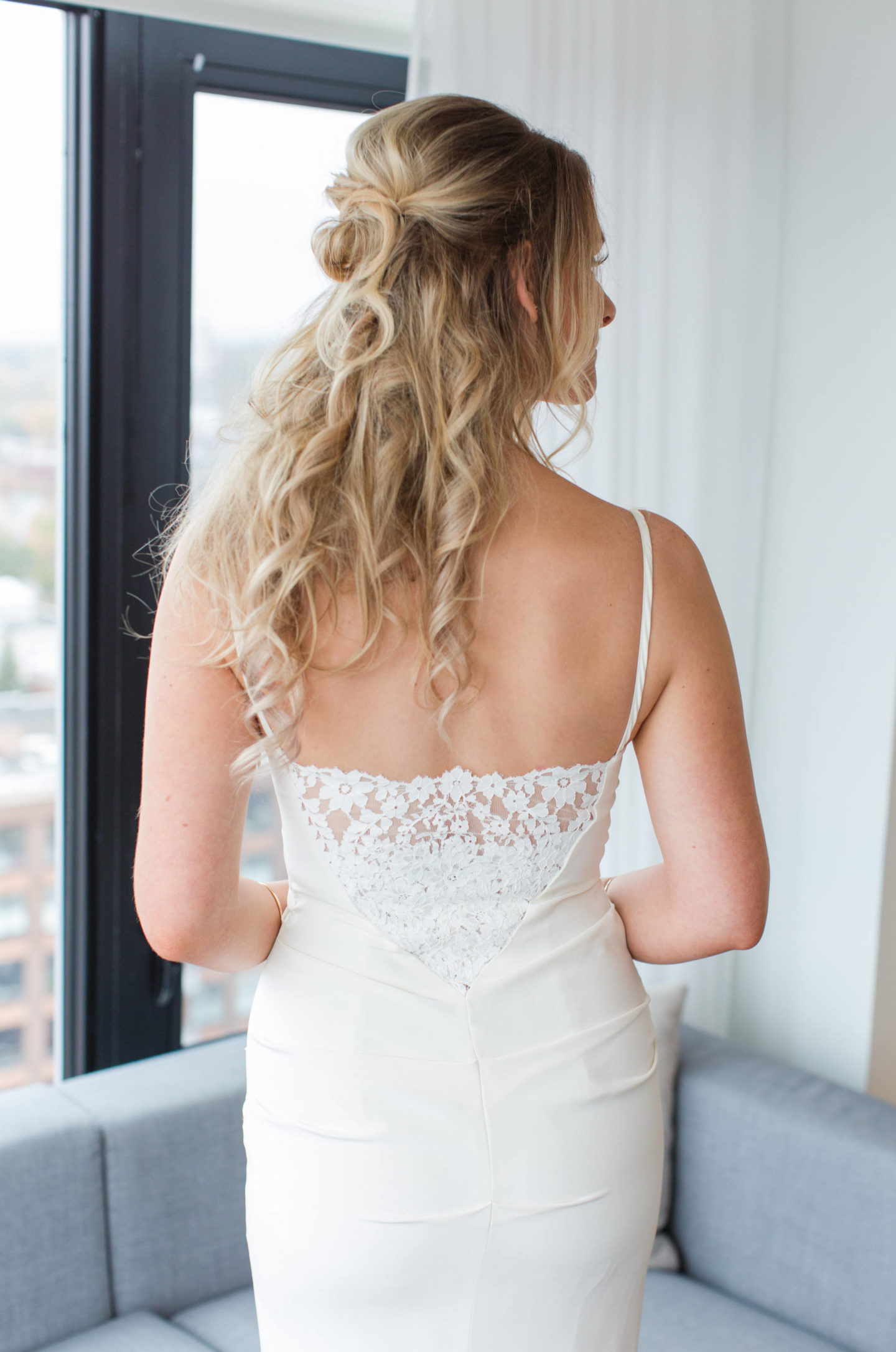 best wedding dress alterations Ottawa, bride in wedding dress with lace back
