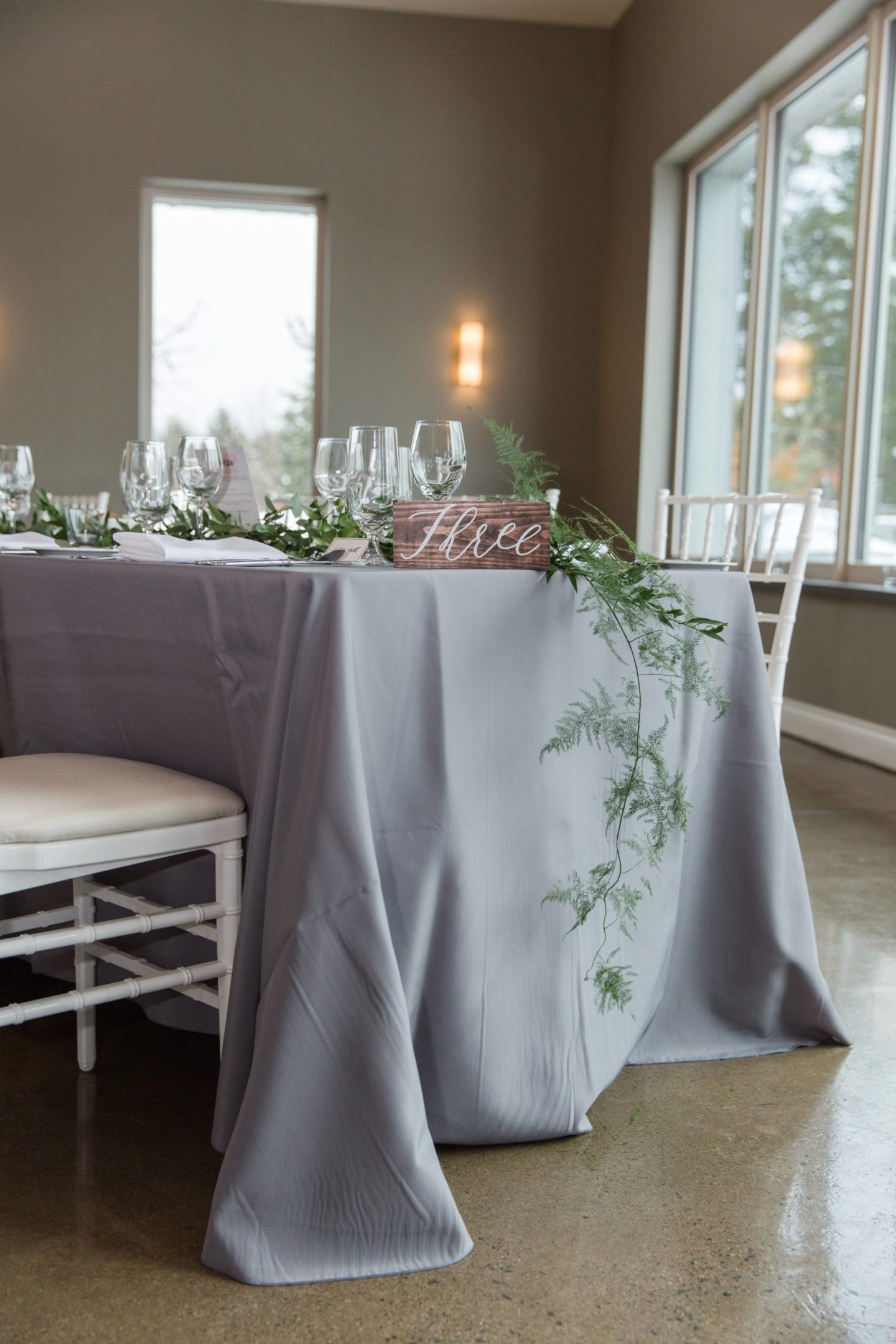best wedding flowers Ottawa, grey tables cape with greenery