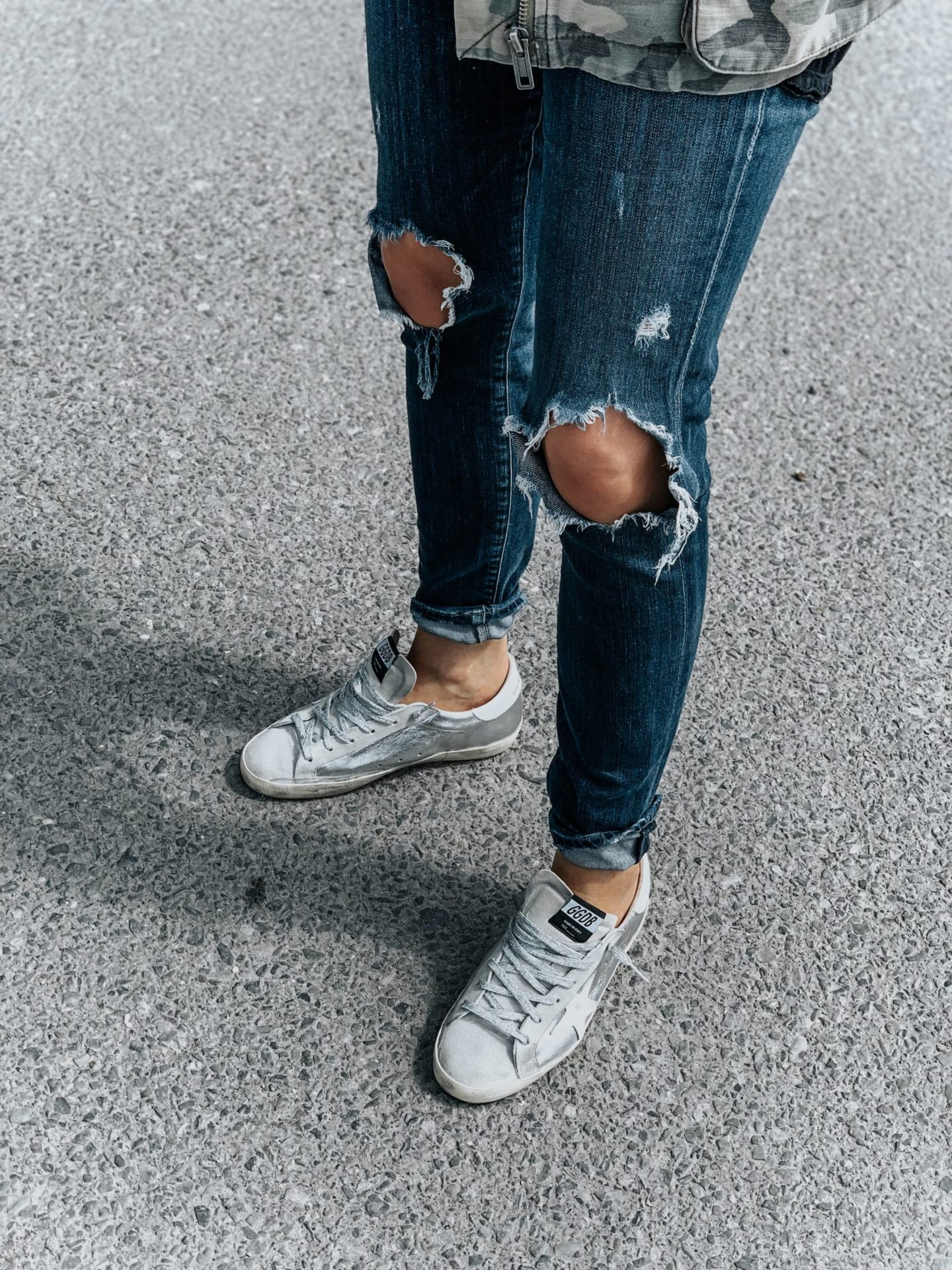 silver golden goose sneakers on girl