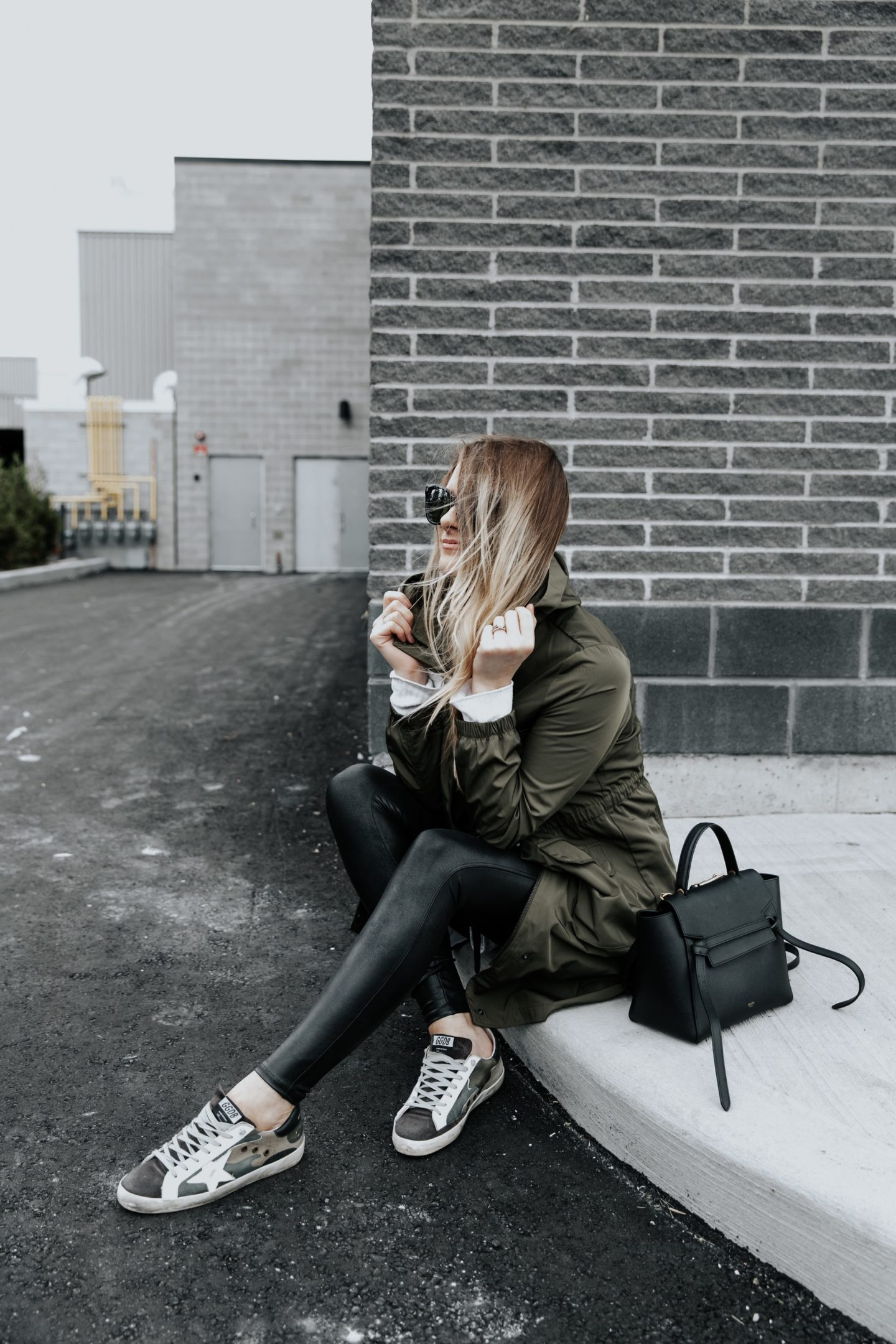 girl sitting wearing cute fall outfit and Celine belt bag