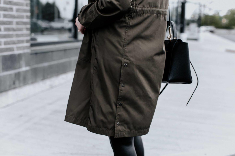 girl wearing avec les filles raincoat
