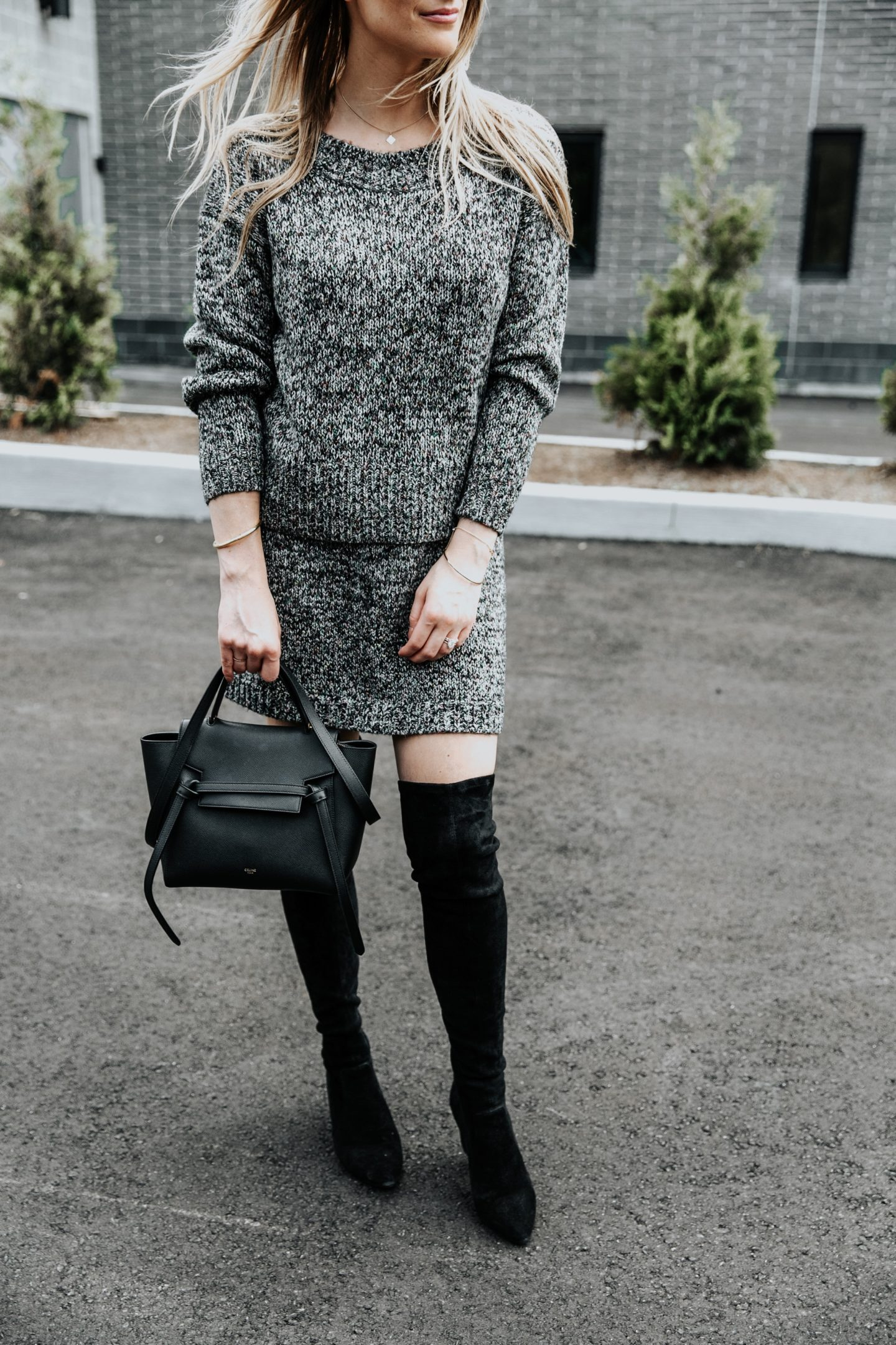 blonde blogger wearing matching set with over the knee boots