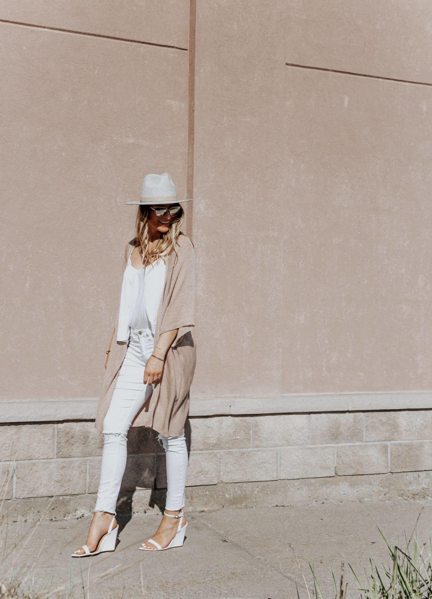 boho photoshoot with blonde blogger in fedora and all white summer outfit