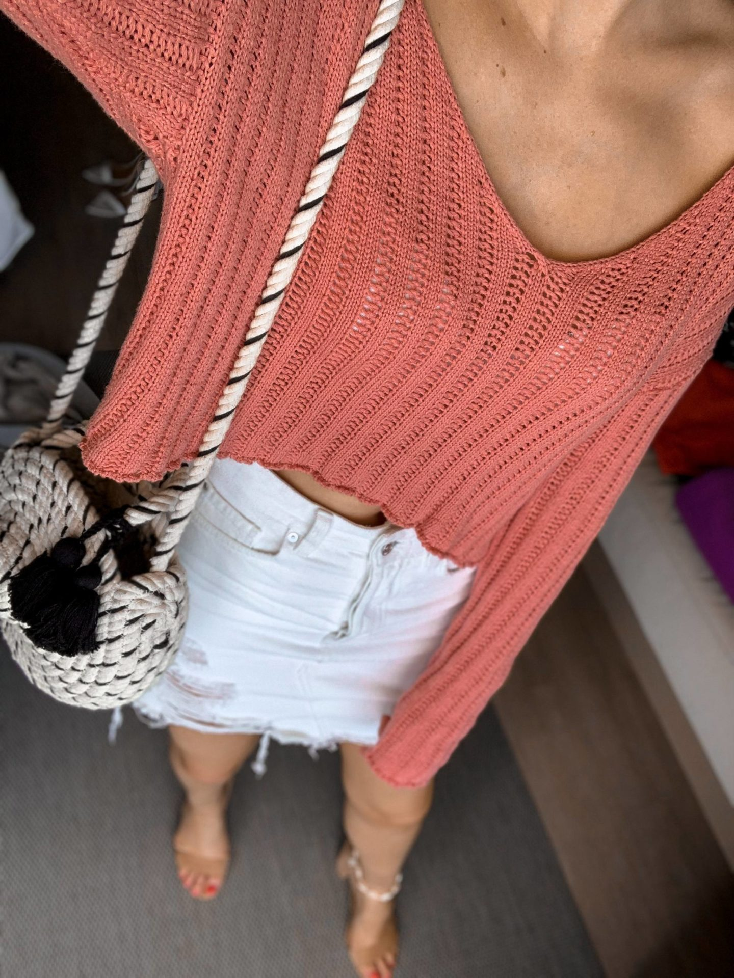 from where I stand blogger in cropped sweater and white denim skirt