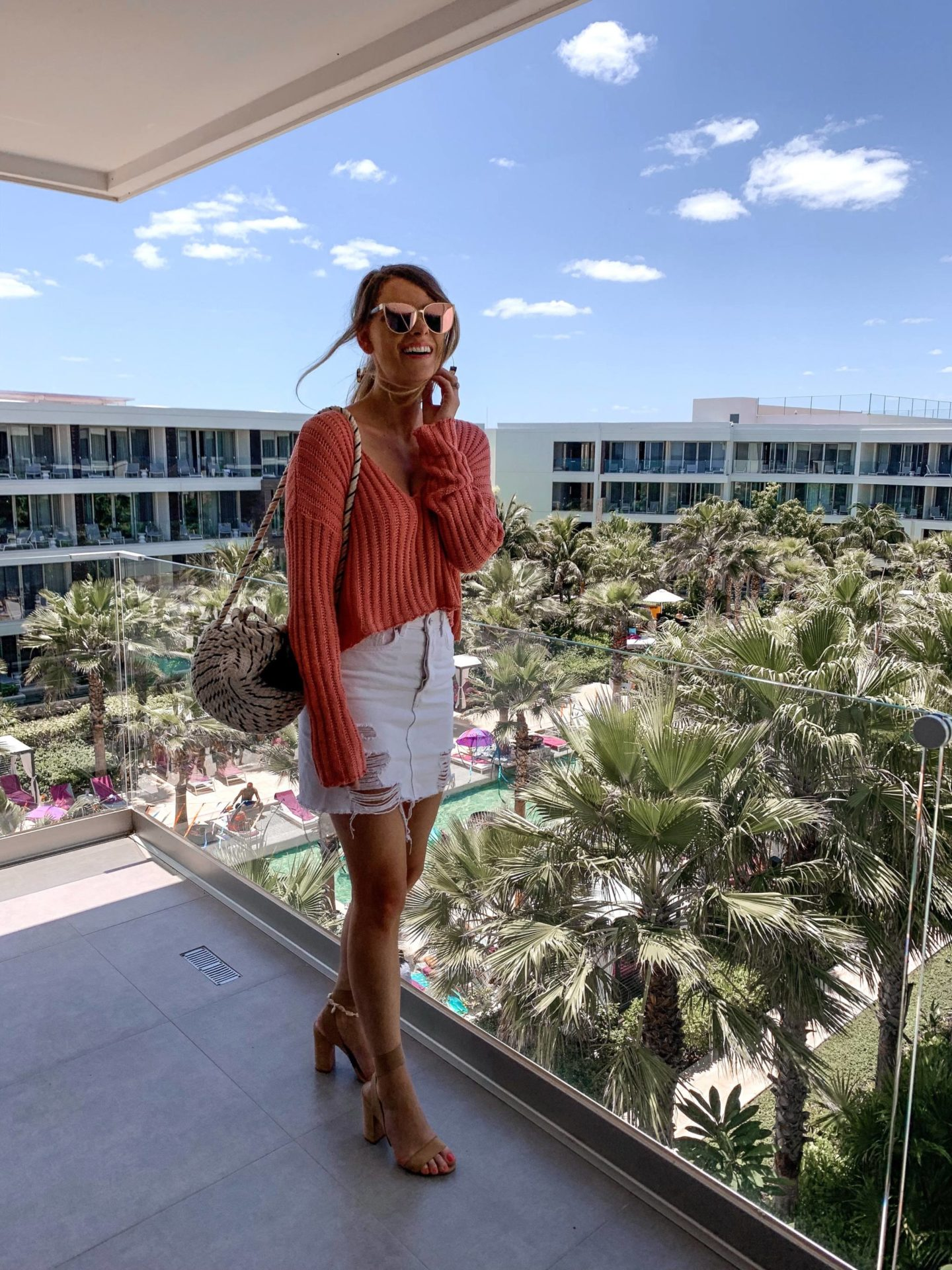fashion blogger at all inclusive resort in cute outfit